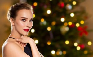 Beautiful Woman Standing in Front of Christmas Tree