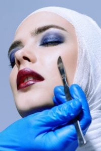 Woman Going Under The Knife For Plastic Surgery